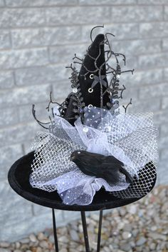 """""""Nevermore"""" will you be a wall flower when you frolic around in comfort this Halloween wearing this lightweight fascinator that ties under your chin. Black Velvet (ties) 10 inch brim; 9 inch tall"""