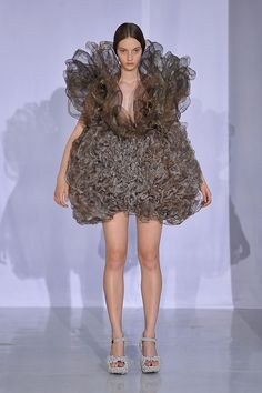 "I love it when ""fashion"" doubles as a Halloween costume.  -Ball of Lint-, -Brillo Pad-, -Hair Ball-"