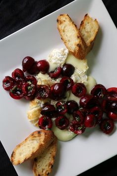 Baking brie isn't the only way to get it good and gooey. For a less-traditional spin, heat the triple-creme cheese over a grill's embers and pair it with a heap of herb-flecked cherries.
