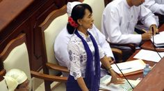 Myanmar's Opposition leader Aung San Suu Kyi asks a question during a regular session of the parliament at Myanmar Lower House, in Naypyitaw, Myanmar, on Wednesday, July 25, 2012. (AP / Khin Maung Win)