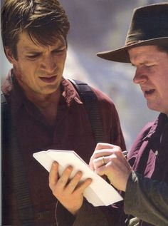 Nathan Fillion and Joss Whedon behind the scenes filming Serenity.