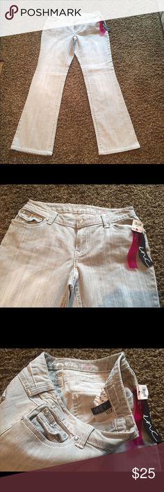 NWT INC Size 10 x 33 Curvy Fit Bootleg NWT INC Size 10 x 33 Curvy Fit Bootleg Jeans. Brand new with tags. Never worn. INC International Concepts Jeans Boot Cut