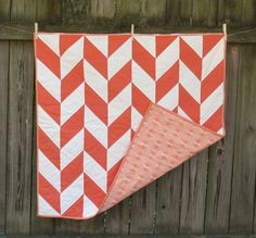 Coral and Apricot Aztec Herringbone Baby Quilt by TwinCityQuiltCo