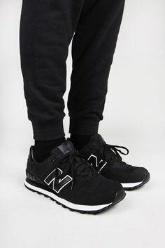 black new balance 574 on feet