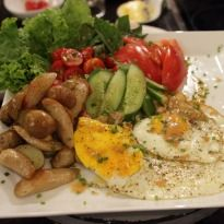 Breakfast Salad Recipe by Aditya Bal @ NDTV GoodTimes Bachelor' s Kitchen - A quick and crisp breakfast salad with chicken sausages, eggs, lettuce, capsicum and tomatoes. Garnish with a honey mustard dressing.