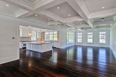 Giant open floor plan. Love the hardwood and the ceiling!