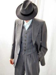 wishing men still wore hats w/ their suits. Hot!