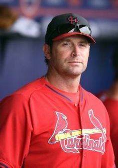 manager Mike Matheny in the dugout during a spring training game against the Mets. 3-24-14