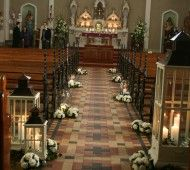 Candles and white flowers for church wedding
