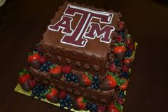Graduation - Texas A&M square 2 tiered chocolate graduation cake with strawberries, blueberries & raspberries