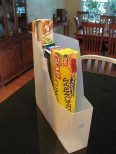 Use a magazine holder to keep all those boxes of plastic wrap and tin foil from falling everywhere in your cabinets. I just hate when that happens! This looks like it would help solve the problem of not being able to keep some things in a drawer. Now you can store everything neatly in the pantry & save that drawer space!
