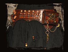 ceinture de cuir alchimiste     alchemist leather utility belt. $225.00, via Etsy.