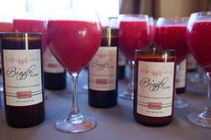http://www.wienscellars.com/temecula-wedding/  Upcycled wine bottle candles  Wedding favors