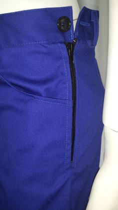 Pants - Zip fastening with button detail.