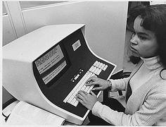 No original caption. [African-American woman computer operator], 1972 - 1991