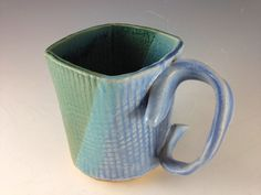 A handmade stoneware mug, the Blue Green Diagonal Dip has a sweet diagonal dip overlapping some of that glaze goodness.This mug features my specialty, the Ribbon Handle--as sweet to hold as it is to see!