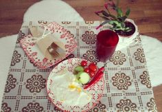 Red retro boho breakfast table with red patterned plates.