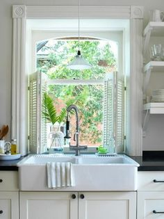 farm house sink & amazing window with shutters!!! <3