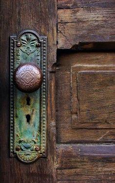 wooden door with patina-ed hardware via google images