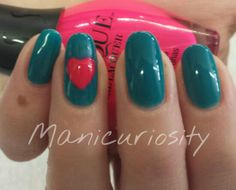 Teal gel polish with a bright pink heart on ring accent finger. :)