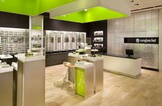A new organizational drawer system is disguised on the back wall using a striking reflective material that references the mirror band wrapping around the store walls. Supplies, such as cleaning cloths, bags and sunglass cases, are now kept within easy reach for employees.View Image Details