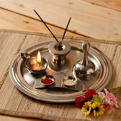 Puja Tray(Hindu)- A special tray used during worship which carries several symbolic Items used within worship,small bell, water-pot, diva lamp and incense burner. Puja involves offering light, incense, flowers and food to the gods.