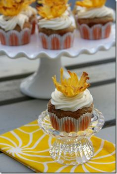 Hummingbird cupcakes with pineapple flowers! The only things I would omit from the recipe is the pecans and coconut.
