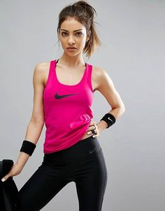 Buy Nike Pro Training Tank Top In Pink at ASOS. With free delivery and return options (Ts&Cs apply), online shopping has never been so easy. Get the latest trends with ASOS now. Gym Wear For Women, Active Wear For Women, Fit Women, Womens Workout Outfits, Fitness Outfits, Nike Swoosh Logo, Gym Clothes Women, Nike Tank Tops, Nike Pros