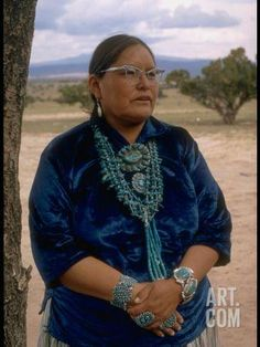 Navajo Woman Modeling Turquoise Squash Blossom Necklace, Bracelets, Pins and Rings Premium Photographic Print by Michael Mauney at Art.com