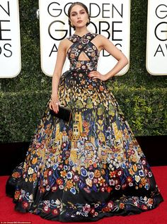 A real eyeful:Olivia Culpo looked as though she had ripped down a wall hanging to make he...