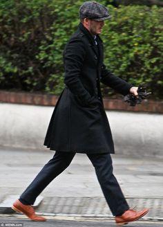 Dapper dude: The 37-year-old footballer looked stylish in a grey baker boy cap as he ran errands in his Bentley