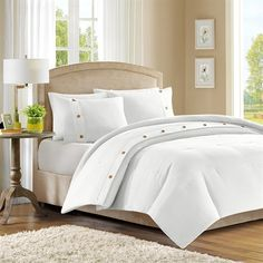 The Madison Park Waffle collection will provide your room with a clean, pure look. The comforter and sham features a white jacquard pattern that is woven into a waffle pattern. The waffle pattern is pieced with a white band strapping with button details. This comforter mini set will make room feel modern and clean.