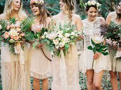 Boho bridesmaids in lace with mismatched bouquets