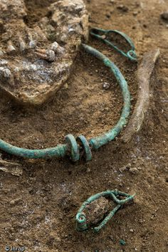Celtic La Tene Era burial from France, bronze torc and fibulae