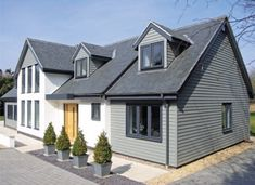 new england style cladding on a chalet bungalow Bungalow Exterior, Bungalow Renovation, Modern Exterior, Exterior Design, House Ideas Exterior, Bungalow Ideas, Craftsman Bungalows, House Exteriors, House Cladding
