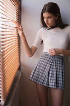 White shirt, plaid skirt, buckle choker