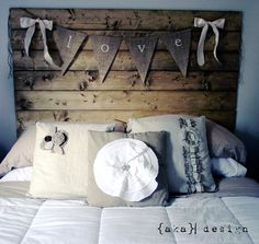 burlap banner so cute above master bed...(and pillows are darling)