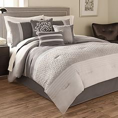 You'll feel comfy and cozy this winter when you dress your bed in the Theo Comforter Set by Hallmart Collectibles. This warm weather suede grey bedding will be perfect for long winter nights and can easily coordinate with any bedroom.