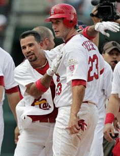 I miss baseballlllll....Rafael Furcal celebrates with David Freese after their 5-4 walk-off win over the Miami Marlins.