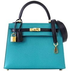 Hermes Kelly 25 Sellier Bag Horseshoe Blue Paon Black Chevre Mysore... ($34,210) ❤ liked on Polyvore featuring bags, handbags, gold bag, hermès, gold purse, blue bag and hermes purse
