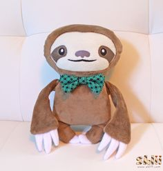 Dapper Sloth is dressed to impress! He proudly wears his fancy bow-tie, waiting for someone to notice his handsomeness. He's in no rush, though;