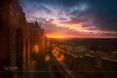 Carcassonne - Sunset from Carcassone (France). Two different images with a gap of 40 minutes between them, to catch the sunset sky and the other one to catch the lights of the castle on. Hope you like it!!