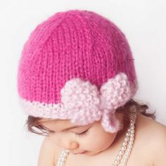 The cutest hat reminiscent of the flapper girl look. This one is in soft bright phlox pink mohair yarn and edged in light pink and accented with a darling bow. Perfect for portraits!