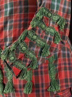 Detail of Sir John Hynde Cotton's tartan suit. Date 1744 Made from Fine hard tartan faced with green silk and embellished with braid and tassels Tartan Suit, 18th Century Fashion, Traditional Fashion, Green Silk, Rococo, Baroque, Plaid Scarf, Costumes, Suits