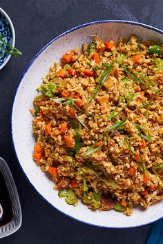 Make cauliflower fried rice with bacon, ginger and garlic for a quick and flavorful weeknight meal that won't have you missing the white rice.