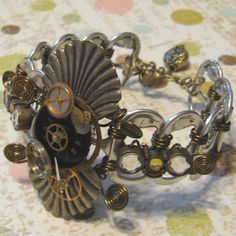 Recycled Watch Parts Soda Can Tabs Steampunk Bracelet Wire Wrapped by GoGoGirlz, via Flickr