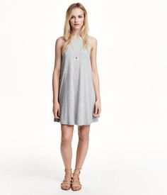 Sleeveless, A-line dress in jersey. Slightly deeper armholes, double-layer fabric at top, and side-seam pockets.