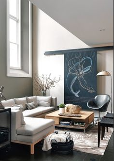 sliding wall art to hide a TV