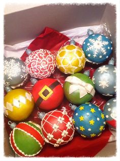 """I made the tops from a half ball pan. The bottoms were cupcakes I cut flat then iced, then set the completed """"half ball ornament"""" on top. They're more like a """"double cupcake."""" :)  Mmf and royal icing."""