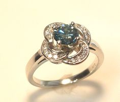 Blue diamond in flower ring  www.troyshoppejewellers.com